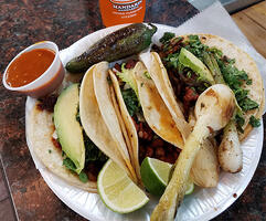 El Jarochito Tacos with hot sauce and jarrito