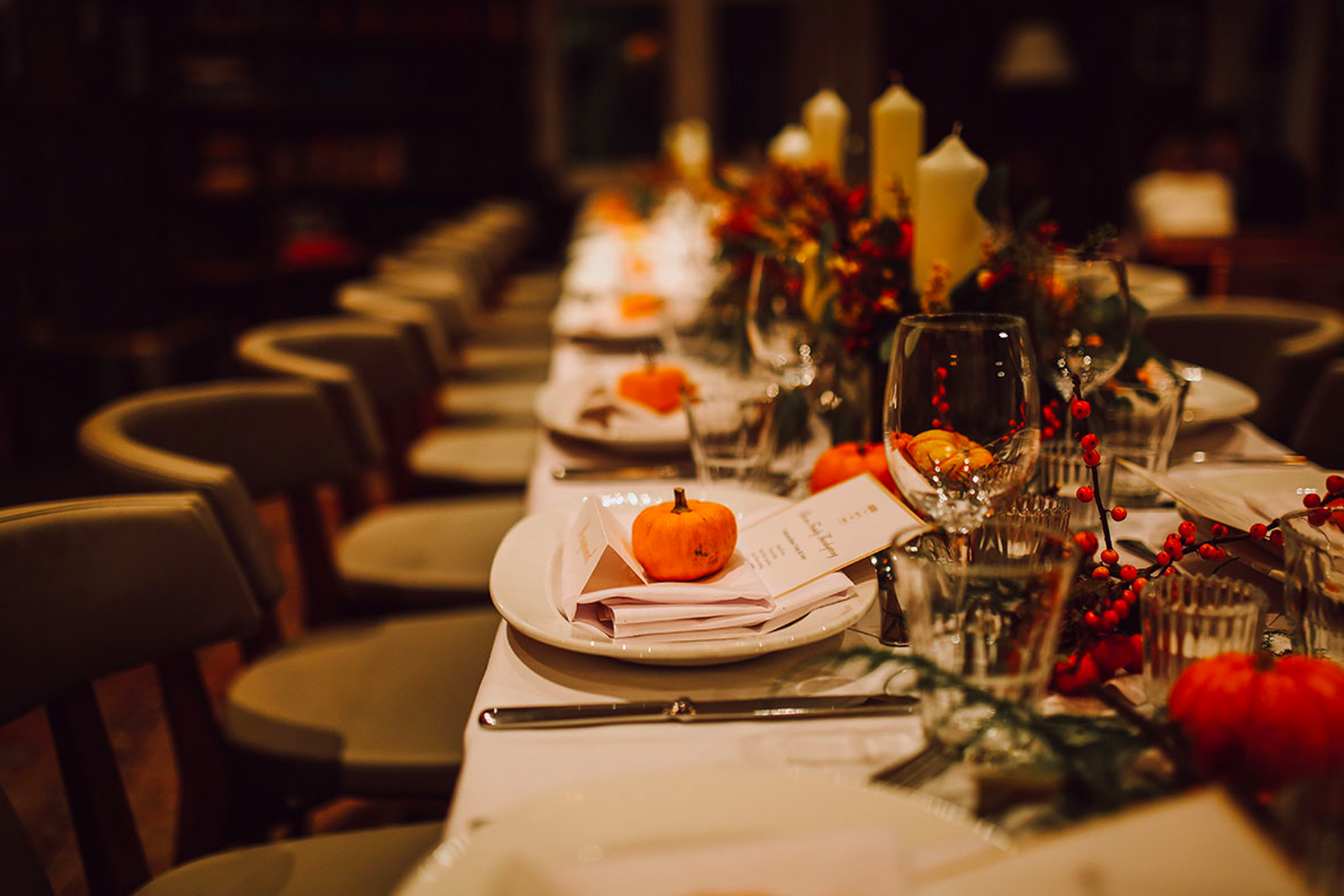Fall themed restaurant setting with long table and chairs